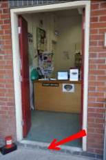 Entrance to Shop. Arrow indicates step up.